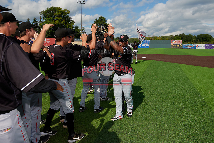 Batavia Muckdogs Albert Guaimaro (13) high fives teammates after clinching the Pinckney Division Title during a NY-Penn League game against the Auburn Doubledays on September 2, 2019 at Falcon Park in Auburn, New York.  Batavia defeated Auburn 7-0 to clinch the Pinckney Division Title.  (Mike Janes/Four Seam Images)