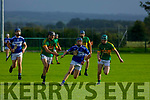 St Brendans Sean Brosnan been chalanged by Darragh Conway of Lixnaw in the County Minor Hurling championship quarter final on Friday.