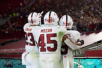 LOS ANGELES, CA - SEPTEMBER 11: Ryan Johnson #23, Ricky Miezan #45 and Noah Williams #9 of the Stanford Cardinal look out to the cheering Stanford fans after a pick-six by Kyu Blu Kelly #17 during a game between University of Southern California and Stanford Football at Los Angeles Memorial Coliseum on September 11, 2021 in Los Angeles, California.
