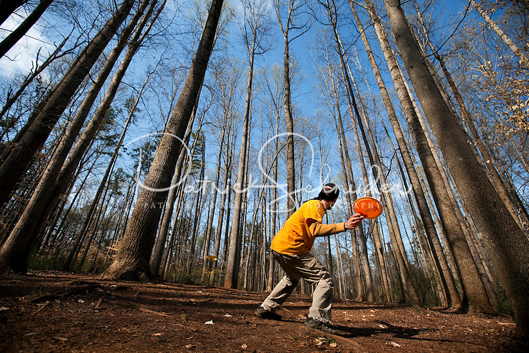 """Charlotte Disc golfers take part in the """"Carolina Clash 2009"""" at Hornet's Nest Park, in Charlotte, North Carolina. Photo taken as part of a series of spring scenes in North Carolina by Charlotte photographer Patrick Schneider."""