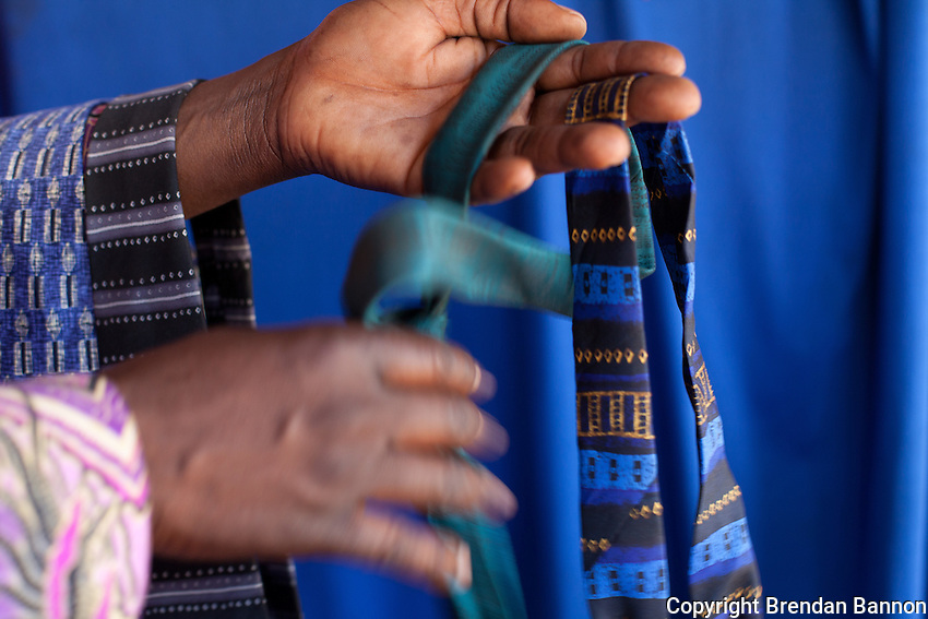 """Peter Olendo keeps a cache of neck ties for customers to  wear at his  photo studio in Kibera.            Olendo also has clip on ties for those """"with no time to waste."""""""
