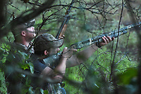 Jake Taylor (left) eyes incoming doves while Matt Hughest takes a shot Sept. 5 2020 on the opening day of dove hunting season. <br />