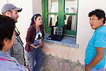 Andean Mountain Cat (Leopardus jacobita) biologists, Juan Reppucci, Cintia Tellaeche, and conservationist, Romina Matamala, talking to government official about Andean cats, Abra Granada, Andes, northwestern Argentina