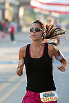 Image of a runner in one of the 2009 Quad Cities Marathon events.