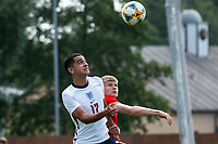 3rd September 2021; Newport, Wales:  Sonny Perkins England and Jordan James of Wales challenge for the ball during the U18 International Friendly match between Wales and England at Newport Stadium in Newport, Wales.
