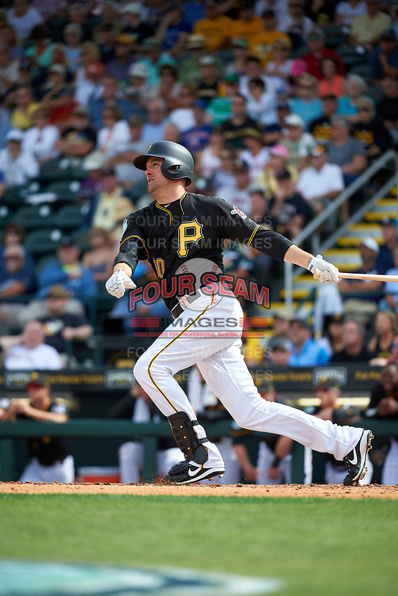 Pittsburgh Pirates shortstop Jordy Mercer (10) follows through on a swing during a Grapefruit League Spring Training game against the New York Yankees on March 6, 2017 at LECOM Park in Bradenton, Florida.  Pittsburgh defeated New York 13-1.  (Mike Janes/Four Seam Images)