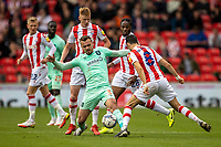 11th September 2021;  Bet365 Stadium, Stoke, Staffordshire, England; EFL Championship football, Stoke City versus Huddersfield Town; Harry Toffolo of Huddersfield Town challenged by Mario Vrancic of Stoke City