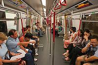 People traveling on the subway, Hong Kong, China.