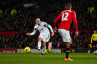 Saturday 11 January 2014 Pictured: Jonjo Shelvey of Swansea kicks the ball forwards<br /> Re: Barclays Premier League Manchester Utd v Swansea City FC  at Old Trafford, Manchester