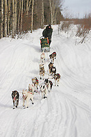 Ed Iten on the trail after leaving the Kaltag checkpoint.  2005 Iditarod Trail Sled Dog Race.