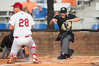Home plate umpire Kaz Endo calls Logan Ratledge (25) of the Bristol Pirates out at home plate during the game against the Johnson City Cardinals at Howard Johnson Field at Cardinal Park on July 6, 2015 in Johnson City, Tennessee.  The Pirates defeated the Cardinals 2-0 in game one of a double-header. (Brian Westerholt/Four Seam Images)