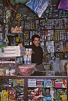 Fez, Morocco - Shopkeeper.  Vendor of Candy, Canned Goods, Foodstuffs, Clothes, Olives, Eggs, Jam, Sundry Items.