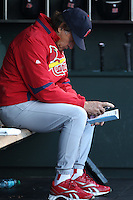 SAN FRANCISCO - APRIL 24:  Manager Tony La Russa #10 of the St. Louis Cardinals looks at his line up card in the dugout during the game against the San Francisco Giants at AT&T Park on April 24, 2010 in San Francisco, California. Photo by Brad Mangin
