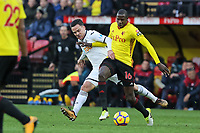 (L-R) Roque Mesa of Swansea City challenged by Abdoulaye Doucoure of Watford during the Premier League match between Watford and Swansea City at the Vicarage Road, Watford, England, UK. Saturday 30 December 2017
