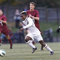 Boston College midfielder Derrick Boateng (10) on the attack. Boston College (white) defeated Harvard University (crimson), 3-2, at Newton Campus Field, on October 22, 2013.