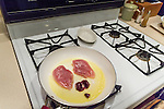 Ruffed grouse cooking in a pan