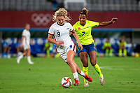 TOKYO, JAPAN - JULY 21: Lindsey Horan #9 of the United States evades Madelen Janogy #7 of Sweden during a game between Sweden and USWNT at Tokyo Stadium on July 21, 2021 in Tokyo, Japan.