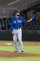 AZL Rangers relief pitcher Luis Rosario (76) waits to receive the ball back from the catcher during an Arizona League game against the AZL Giants Black at Scottsdale Stadium on August 4, 2018 in Scottsdale, Arizona. The AZL Giants Black defeated the AZL Rangers by a score of 6-3 in the second game of a doubleheader. (Zachary Lucy/Four Seam Images)