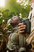 Man looking up, Odzala-Kokoua National Park.