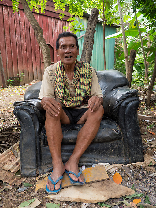 This old man still enjoys his old arm chair in a small village some distance from Battambang, Cambodia.