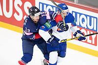 23rd May 2021, Riga Olympic Sports Centre Latvia; 2021 IIHF Ice hockey, Eishockey World Championship, Great Britain versus Slovakia;  13 David Phillips Great Britain and 88 Kristian Pospisil Slovakia hunting the puck