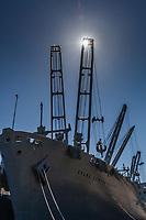 Moored near the USS Hornet Museum in Alameda is the crane ship, The Grand Canyon State, captured here with a sunburst shining from atop one of the cranes.