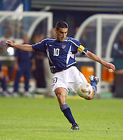 Captain Claudio Reyna sends the ball upfield. The USA lost 3-1 against Poland in the FIFA World Cup 2002 in Korea on June 14, 2002.