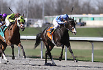 Orchestrator with Alex Solis (blue cap) outruns Age of Humor with Russell Baze to win The Bourbonette Oaks at Turfway Park. 03.27.2010