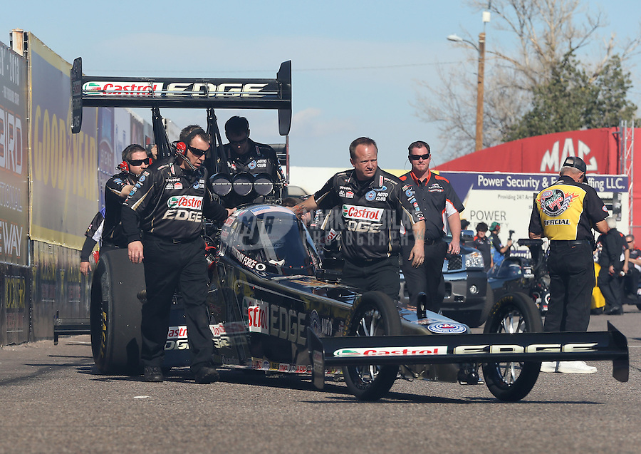 Feb. 22, 2013; Chandler, AZ, USA; NHRA crew members for top fuel dragster driver Brittany Force during qualifying for the Arizona Nationals at Firebird International Raceway. Mandatory Credit: Mark J. Rebilas-