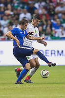 United States' forward Jordan Morris (8) and Mexico's forward Eduardo Herrera (20) vying for ball possesion during second period of an international friendly at the Alamodome, Wednesday, April 15, 2015 in San Antonio, Tex. USA defeated Mexico 2-0. (Mo Khursheed/TFV Media via AP Images)