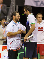 September 14, 2014, Netherlands, Amsterdam, Ziggo Dome, Davis Cup Netherlands-Croatia, Marin Cilic (CRO) wins the dividing rubber 3-2 Croatia and is congratulated by his captain<br /> Photo: Tennisimages/Henk Koster