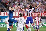 Atletico de Madrid´s Diego Godin (R) and Real Madrid´s goalkeeper Iker Casillas and Coentrao during 2014 Supercopa de España `Spain Supercup´ second leg match at Vicente Calderon stadium. August 22, 2014. (ALTERPHOTOS/Victor Blanco)