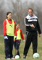 Head coach Jim Gabarra with Homare Sawa during Washington Freedom  practice and media event at the Maryland Soccerplex on March 25 in Boyd's, Maryland.