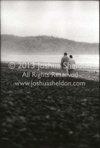 Couple walking on beach<br />