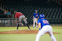 AZL Diamondbacks starting pitcher Wilfry Cruz (11) checks the runner at first base during the game against the AZL Cubs on August 11, 2017 at Sloan Park in Mesa, Arizona. AZL Cubs defeated the AZL Diamondbacks 7-3. (Zachary Lucy/Four Seam Images)