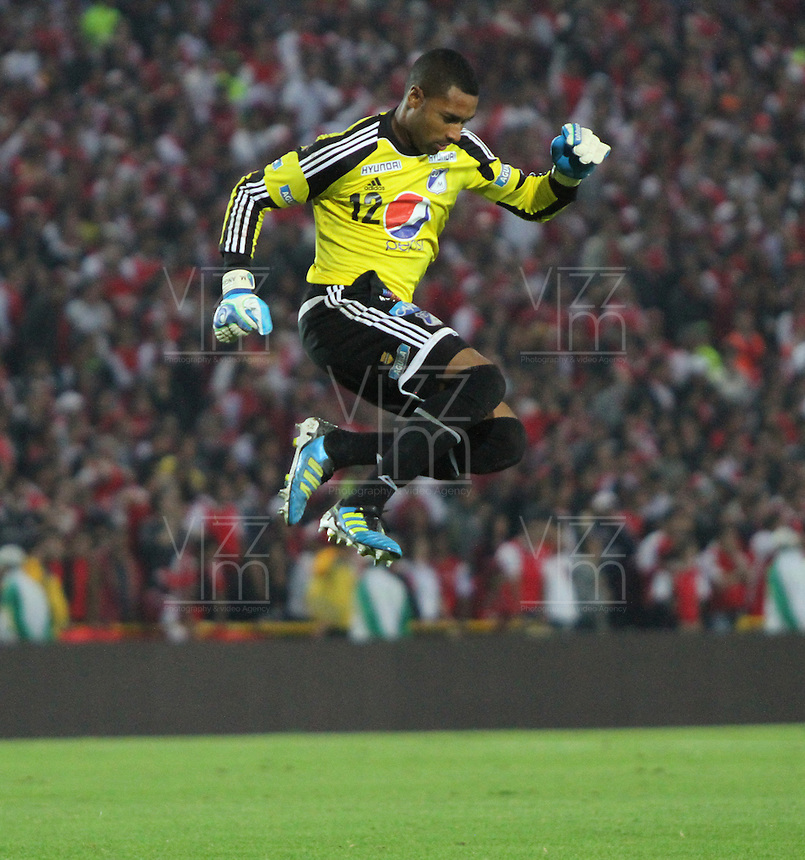 BOGOTA, COLOMBIA -APRIL 6: Robinson Zapata goalkeeper  of Millonarios celebrates a goal against  Santa Fe during a match between Santa Fe and Millonarios as part of the Liga Postobon 2013 at  Nemesio Camacho El Campin  stadium on March 30, 2013 in Neiva, Colombia. (Photo /Vizzorimge/ Felipe Caicedo / Staff)