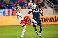 Fabian Espindola (9) of the New York Red Bulls and Kalifa Cisse (4) of the New England Revolution. The New York Red Bulls defeated the New England Revolution 4-1 during a Major League Soccer (MLS) match at Red Bull Arena in Harrison, NJ, on March 20, 2013.