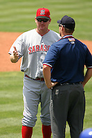 April 12, 2009:  Base Umpire Brandon Musin explains a call to Manager Joe Ayrault of the Sarasota Reds Florida State League Class-A affiliate of the Cincinnati Reds, during a game at Tradition Field in St. Lucie, FL.  Photo by:  Mike Janes/Four Seam Images