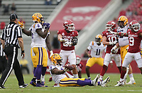 Arkansas linebacker Grant Morgan (31) reacts after taking down LSU tight end Arik Gilbert (2), Saturday, November 21, 2020 during the second quarter of a football game at Donald W. Reynolds Razorback Stadium in Fayetteville. Check out nwaonline.com/201122Daily/ for today's photo gallery. <br /> (NWA Democrat-Gazette/Charlie Kaijo)