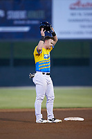 Alex Destino (23) of the Rapidos de Kannapolis wipes sweat off his head as he stands on second base during the game against the Greensboro Grasshoppers at Kannapolis Intimidators Stadium on June 14, 2019 in Kannapolis, North Carolina. The Grasshoppers defeated the Rapidos de Kannapolis 4-1. (Brian Westerholt/Four Seam Images)