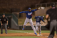 Los Angeles Dodgers first baseman Ibandel Isabel (90) catches a ball over the head of Cesar Izturis Jr (21) during a Minor League Spring Training game against the Seattle Mariners at Camelback Ranch on March 28, 2018 in Glendale, Arizona. (Zachary Lucy/Four Seam Images)