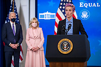 US President Joe Biden and First Lady Dr. Jill Biden listen to remarks by Megan Rapinoe, of the U.S. Soccer Women's National Team, during an event to mark Equal Pay Day in the State Dining Room of the White House in Washington, DC, USA, 24 March 2021. Equal Pay Day marks the extra time it takes an average woman in the United States to earn the same pay that their male counterparts made the previous calendar year.<br /> CAP/MPI/RS<br /> ©RS/MPI/Capital Pictures