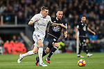 Toni Kroos (l) of Real Madrid fights for the ball with Guilherme dos Santos Torres of RC Deportivo La Coruna during the La Liga match between Real Madrid and RC Deportivo La Coruna at the Santiago Bernabeu Stadium on 10 December 2016 in Madrid, Spain. Photo by Diego Gonzalez Souto / Power Sport Images