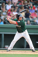 Catcher Tim Roberson (15) of the Greenville Drive bats in a game against the Charleston RiverDogs on Sunday, May 19, 2013, at Fluor Field at the West End in Greenville, South Carolina. Charleston won, 9-7. (Tom Priddy/Four Seam Images)
