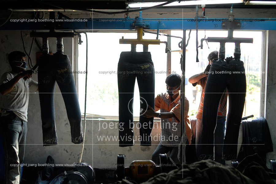 BANGLADESH, textile industry in Dhaka, company Beximco produce Denim trouser for export for western discounter, department styling and special effects / BANGLADESH, Textilbetrieb Beximco in Dhaka produziert Jeanshosen fuer den Export fuer westliche Textildiscounter u.a. Tom Tailor, Abteilung styling mit Schleifpapier und speziellen Effekten