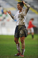 Carli Lloyd drenched in mud at the US vs Norway game in Olhao, Portugal during the 2010 Algarve Cup.