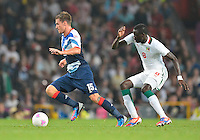 July 26, 2012..Britain's Aaron Ramsey (15) and Senegal's Cheikhou Kouyate (8). Great Britain vs Senegal Football match during 2012 Olympic Games at Old Trafford in Manchester, England. Senegal held Great Britain to a 1-1 draw...(Credit Image: © Mo Khursheed/TFV Media)