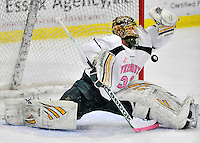 28 January 2012: University of Vermont Catamount starting goaltender Alex Vazzano, a Sophomore from Trumbull, CT, in first period action against the visiting Northeastern University Huskies at Gutterson Fieldhouse in Burlington, Vermont. The Catamounts, dressed in their Breast Cancer Awareness jerseys, fell to the Huskies 4-2 in the second game of their 2-game Hockey East weekend series. Mandatory Credit: Ed Wolfstein Photo