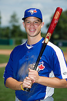 Braxton Davidson (23) of T.C. Roberson High School in Asheville, North Carolina poses for a photo while playing for the Toronto Blue Jays scout team during the East Coast Pro Showcase on August 2, 2013 at NBT Bank Stadium in Syracuse, New York.  (Mike Janes/Four Seam Images)