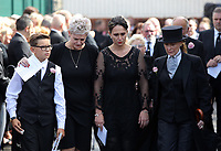 """COPY BY TOM BEDFORD<br /> Pictured: Gemma Black, the mother of Pearl Black (3rd L) exits the chapel supported by family and friend after the service out of the Jerusalem Baptist Chapel in Merthyr Tydfil, Wales, UK. Friday 18 August 2017<br /> Re: The funeral of a toddler who died after a parked Range Rover's brakes failed and it hit a garden wall which fell on top of her will be held today at Jerusalem Baptist Chapel in Merthyr Tydfil.<br /> One year old Pearl Melody Black and her eight-month-old brother were taken to hospital after the incident in south Wales.<br /> Pearl's family, father Paul who is The Voice contestant and mum Gemma have said she was """"as bright as the stars""""."""